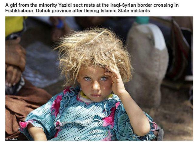 Dohuk行政区で争いを避け、イラクとシリアの国境を越えた地点で休む少数派のヤジディ教徒の少女
